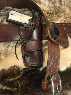 Excited to share this item from my shop: Western style leather Colt 1911 gun rig with to gun belt, leather 1911 pistol holster and a mag holder for single stack 1911 Holster, Pistol Holster, Colt 1911, 1911 Pistol, Custom Leather Holsters, Western Holsters, Cowboy Action Shooting, Thing 1, Leather Working