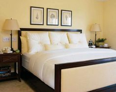 Wonderful yellow color for bedroom walls. Love the upholstered bed, too.