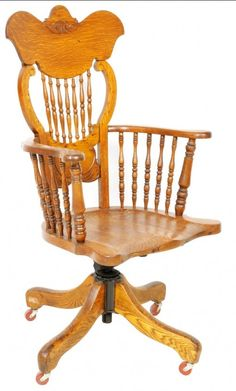 A Tiger Oak Swivel Armchair Late 19th Century / Early 20th Century with turned lyre shaped Windsor back splat.