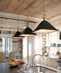 the wood ceilings and book/spice shelves make this kitchen so cozy