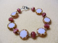 Beautiful bracelet with pink Czech Glass beads with opaque pink and fuchsia swirled beads available on Cassea Designs
