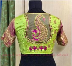 Beautiful radium green color designer blouse with dancing peacock elephant design hand embroidery thread work.  19 August 2017