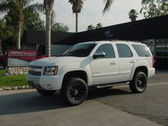Chevrolet tahoe white lifted fender flares blacked out grill 2007 2012 chevy tahoe avalanche 4 cst suspension lift kit 4x4 suburban publicscrutiny Image collections