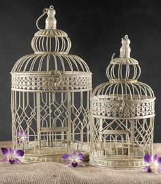 """Set of Two Cream Round Metal Bird Cages (18"""" & 15"""") $25.. Maybe thread a light kit thru and turn into a light fixutre."""
