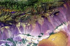 Bogda Mountains – September 1st, 1999  The Turpan Depression, nestled at the foot of China's Bogda Mountains, is a strange mix of salt lakes and sand  dunes, and is one of the few places in the world that lies below sea level.