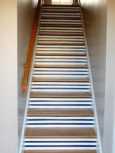 Give your home a nautical look by painting stripes on your stairs. http://www.ivillage.com/staircase-designs/7-a-533138