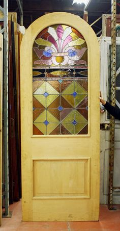 Arched exterior door w/stained glass
