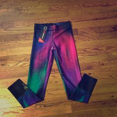 NWT! Zara Terez NY workout legging in Galaxy NWT! Zara Terez NY workout legging in Galaxy multicolor. Moisture wicking-Anti- odor- Stain release. Fabric 80% polyester 20% spandex Zara Terez ZT Performance Apparel Pants Leggings