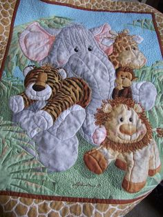"""Quiltfairy Karen brings these adorable Jungle Babies quilts to life. It produces a texture which is a tactile delight and is soothing for little fingers. Heirloom quality for your little one.   Created from Jungle Babies fabric, this 34"""" x 42"""" adorable quilt is perfect for both girls and boys.   This is a craft that I love. Continuous motion quilting was used to outline the animals and palms giving dimension to the design.   Like this design and receive a 15% discount at checkout. Just…"""