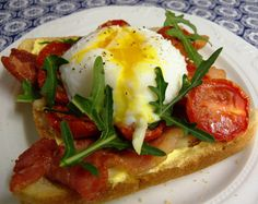 Dulcie & Cubano: Poached egg, bacon, roasted tomatoes and wild rocket on toast