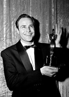 Marlon Brando with his Oscar for On the Waterfront, 1955.....it was mistakenly sold at a France auction years after it had gone missing from Brando's home.