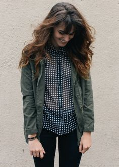 Love the earthy green jacket with black and white top.
