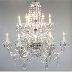 This beautiful chandelier is decorated with 100% crystal that capture and reflect the light of the candle bulbs, each resting in a scalloped bobache. This crystal chandelier is sure to lend a special atmosphere in any home.