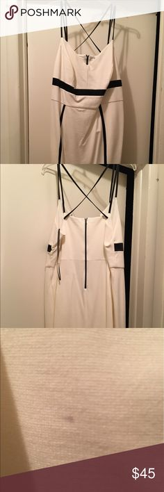 Ready to slay?!? Off white/blk pointe dress!! The picture does not do the dress justice. NWOT. It is absolutely amazing. Off white and black Ponte knot dress with exposed zipper in the back. Crisscross detailing in the back. I think you can crisscross in the front is well if you like. There is a indent in the fabric (see pics). I have no idea how it got there.the dress has been in my closet. Dresses