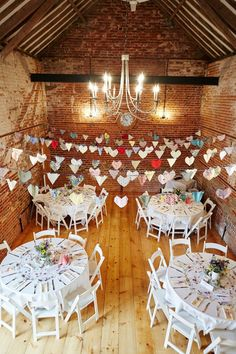 Barn decorated for an English country wedding | Photography by http://www.fullerphotographyweddings.co.uk/
