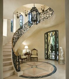 Mediterranean Staircase with Wall sconce, Concrete floors, Custom wrought iron stair railing, Stone Medallions, Arched window Home Stairs Design, Dream Home Design, My Dream Home, Home Interior Design, Interior Stairs, Railing Design, Dream Homes, Luxury Staircase, Marble Staircase