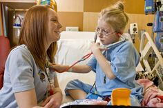 Child Life Specialist and Patient with Stethoscope