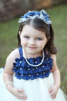 Samantha and Kyle's Savannah, GA Wedding. Samantha's flower girl - her absolutely adorable 3 year old niece in royal blue and white! Photography Jennifer Woodberry #flowergirldresses  See photos on IW www.intimateweddings.com