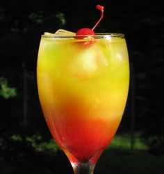 Sex On The Brain (1 oz. Vodka 1 oz. Midori Melon Liqueur 1 oz. Peach Schnapps 2 oz. Pineapple Juice 2 oz. Orange Juice .5 oz Grenadine Cherry to garnish)