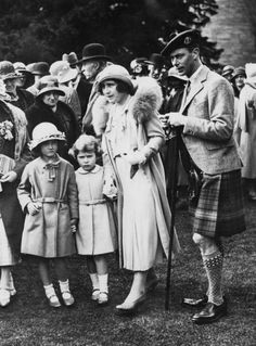 The Duke and Duchess of York, later Queen Elizabeth (1900 - 2002) and King George VI (1895 - 1952), attend a garden party at Glamis Castle in Angus, Scotland, to celebrate the Golden Wedding of the Duchess' parents, the Earl and Countess of Strathmore, August 1931. With them is their daughter Princess Elizabeth (later Queen Elizabeth II) and their niece Diana Bowes-Lyon