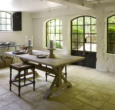 Jill Sharp Brinson's downstairs office. Love the steel doors and stone wall, and...