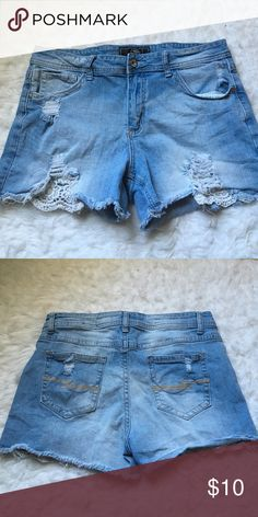 Jean Shorts. Contemporary high waisted (somewhat) Super cute shorts. Lace pockets that show under the jean. Tattered look. Pair with a cute crop top and it's a cute outfit. Jr.Miss/Misses size 14 Shorts Jean Shorts