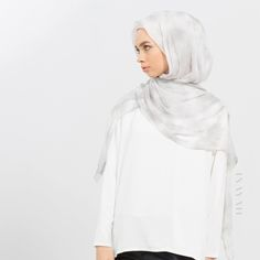 Luxuriously lightweight and easy to style; the ideal hijab choice to be paired with elegant evening wear. Grey Marble Silk Chiffon #Hijab - available online and in-store - www.inayah.co