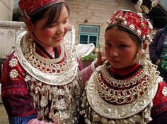 China |  Miao girls wearing lovely silver ornaments.