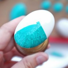 DIY Faux Malachite Knobs - Using a Sharpie Permanent Marker and Porcelain knobs, Unscrew, Paint, bake 350 degrees for 30 minutes.