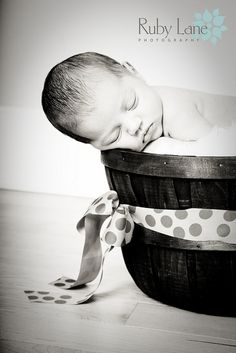 Baby in a basket.  More inspiration for shooting newborns.
