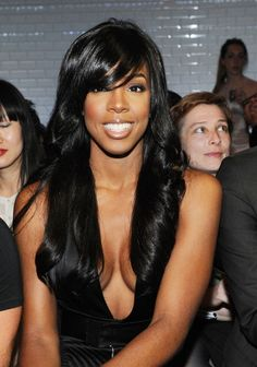 Kelly Rowland Long Black Wavy Hair Style with Side Swept Bangs