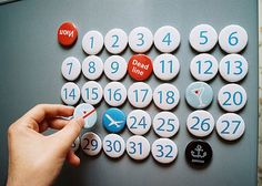 Make your own super-customizable calendar with a bunch of specially decorated magnets. This set, from designer Serhiy Chebotaryov, can be easily reproduced in your office with some computer-generated graphics and an inexpensive button maker.