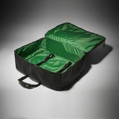 """DIMENSIONS 21"""" W x 8"""" D x 15"""" H MATERIALS Cordura,Nylon Lining DESCRIPTION This medium-sized Kirkman Valise carries clothes as well as business essentials, such as a laptop and documents for 4- to 10-day trips. This soft suitcase encloses the equivalent contents of a carry-on rolling suitcase—with two stacks of clothes, toiletries and two pairs of shoes—while a slim front compartment provides enclosure for electronics or documents. Supple leather keepers wrap around the satinnylon straps… Business Essentials, International Style, Contents, Day Trips, Carry On, Suitcase, Laptop, Satin, Pairs"""
