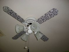 Modge podge scrapbook paper onto fan blades. Fun idea!