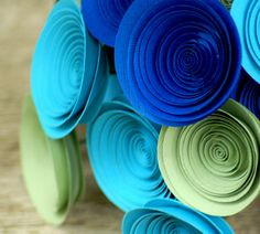 18 Peacock Inspired Paper Flowers in Royal Blue, Turquoise and Sage, Paper Bouquet in Peacock Colors. $36.00, via Etsy.