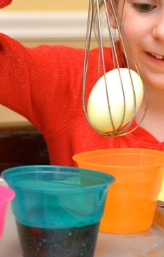 "Decorating Easter Eggs w/ Kids - To get a good ""grip"" on your egg, place it inside a wire whisk. No need to worry about the egg rolling off of a spoon! Many more tips here too. @Valerie at Inner Child Fun"