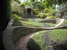 Garden beds certainly don't need to be square, linear or even flat like old plow rows but can meander gracefully in curves like Nature herself.  Devon garden house, UK