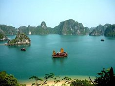 Ha Long Bay is a UNESCO World Heritage Site, and a popular travel destination, located in Vietnam. The bay features thousands of limestone karsts and isles in various sizes and shapes