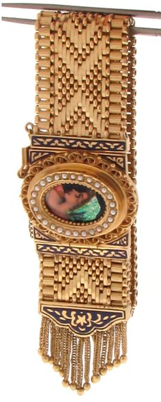 Beautiful Enamel Portrait Gold Bracelet Watch, circa 1960s. Beautiful Enamel Picture/Portrait Bracelet Watch accented by Seed Pearls and black enamel highlights.Watch case 14K; Bracelet, 18K yellow gold; circa: 1960s Via 1stdibs.