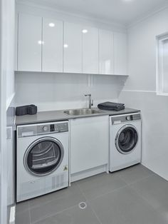 Simple yet versatile Laundry design. #brilliantsa #laundry #renovation #washinmachine #dryer #sink #trough #sinkmixer #overhangcupboards