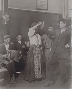 By Lewis Hine - 1905, Immigrants detained on Ellis Island Take Time to be Happy