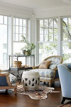 Suzie: New England Home - Gorgeous living room with rope garden stool, zebra cowhide rug, . I want one of the ceramic barrel small tables one day. Style At Home, Coastal Living Rooms, Living Spaces, Cottage Living, Luxury Interior Design, Interior Decorating, Decorating Ideas, Interior Ideas, New England Homes