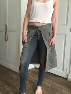 Long overskirts made with recycled French military jackets, 4 pockets, size adjustable with several pressure buttons Sizes: S/M and M/L (model height 176 cm) Color: army Kaki Fabric: Cotton  Original models Series Re-LOV-ution n°9 & n°10