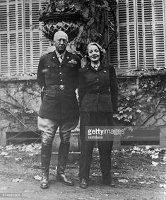 General George Patton and Marlene Dietrich Marlene is wearing an army uniform and Patton is frowning