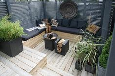 decking seating area with horizontal privacy screen | grey and blonde wood palette