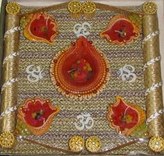 Item: Gel Diya Platter    Details: 5 Gel Diya (1 Large + 4 small) Platter with golden Zari, accessories, and bead work.    Color: Earthen    (The actual products may look different in color, texture, and size from the digital images. Zoom images may take time to display.)    Price: INR: 490    Item #: SU54