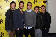 (UK TABLOID NEWSPAPERS OUT) L-R Jason Orange, Howard Donald, Robbie Williams, Mark Owen and Gary Barlow of Take That attend a press conference to announce their new stadium tour Progress Live 2011 held at The Savoy Hotel on October 26, 2010 in London, England.