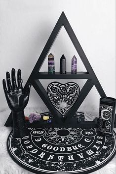 Practical and stylish wooden triangle shelf, all black to match yer soul. Perfect for storing your magical objects, crystals, candles or simply just decorate your wall. Size 54 x / x KILLSTAR Branding Wood. Goth Home Decor, Gypsy Decor, Gothic Bedroom Decor, Creepy Home Decor, Gothic Room, Witch Room, Wiccan Decor, Triangle Shelf, Crystal Shelves