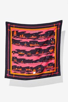 This vintage black Hermès silk scarf has a pink, orange, and red aquatic print, and an Hermès stamp.