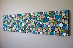 DIY wood slice wall: take a canvas or thin sheet of wood for the background, then paint circles of wood and hot glue them on.   Then, walla! You have your very own wood slice wall.   And, btw, it doesn't have to be that big, and the wood slices don't have to be that small. Just a note.